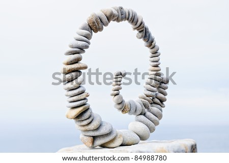 Pebbles curl on the stone at the sea