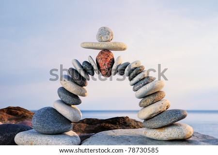 Pebbles curved as arch on the seashore