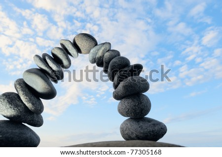 Pebbles curved in an arc against the blue sky