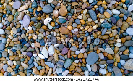 Pebbles on a beach, pebbles background. Summer concept.
