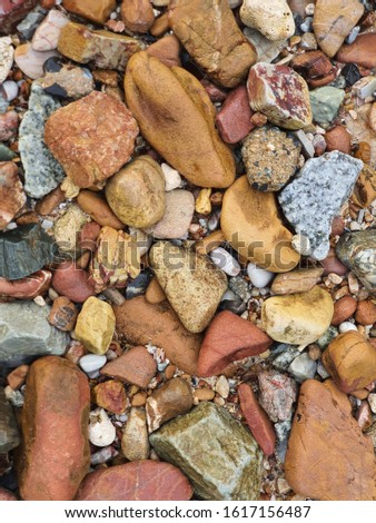 Pebbles on beach Close up. Colorful small pebble and stone texture. form From Koh Lan, Thailand.
