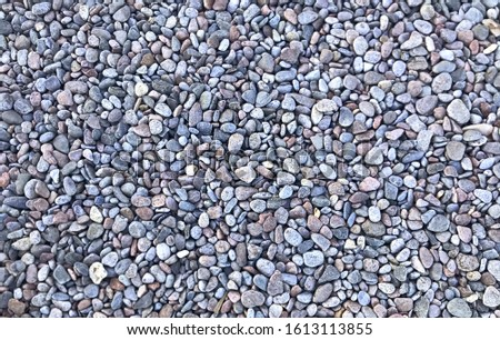 Pebbles on the beach, round rocks, grey pebbles, pebbles texture, pebbles background
