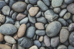Pebbles or river stone background with vintage filter