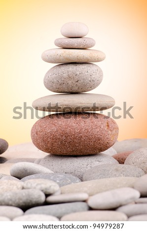 Pebbles stack against gradient background