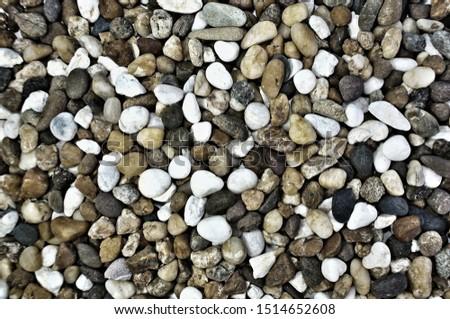 Pebbles texture background. Pebbles texture in dark tone.