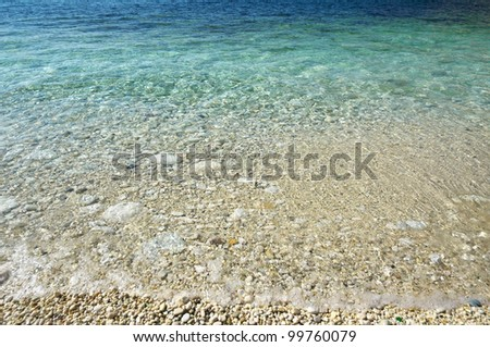 Pebbly beach coastline with turquoise water.