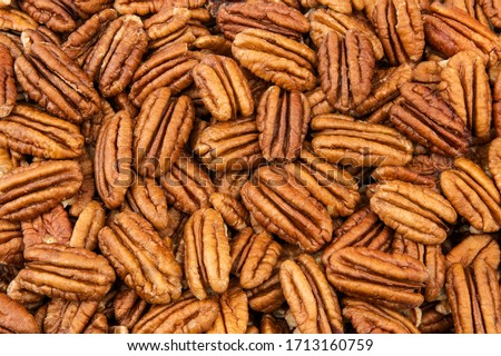 Pecan nuts as a background Foto stock ©