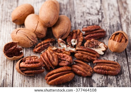Shutterstock Pecan nuts on a wooden table