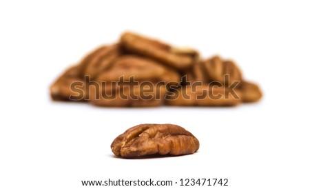 Pecan nuts on white background with selective focus on front nut