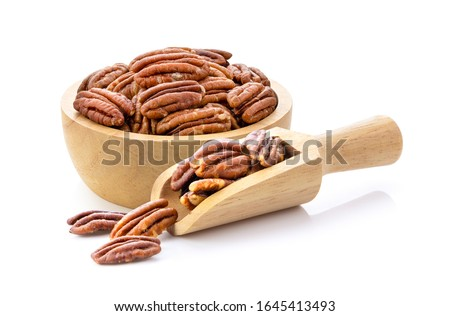 Pecan nuts topped with light salt in wood scoop and bowl  isolated  on white background Foto stock ©