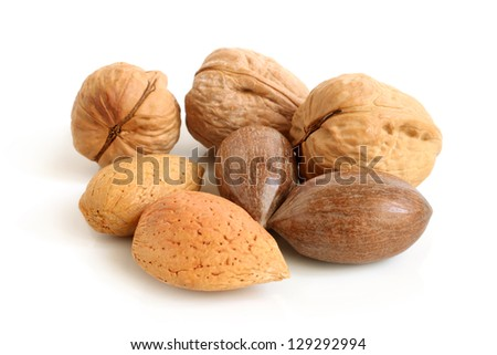 Pecan nuts, walnuts and almonds on a white background