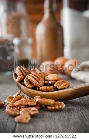 Pecans in a wooden spoon