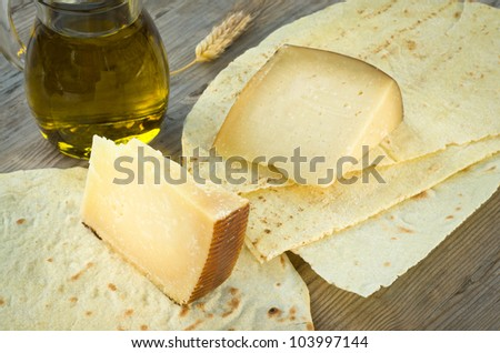 Pecorino Sardo and Carasau bread, typical food of Sardinia - stock photo