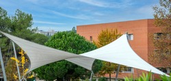Peculiar shape awning to protect from sun and rain.