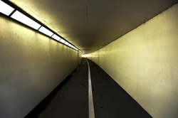 Pedestrian and cycle tunnel receding to vanishing point.