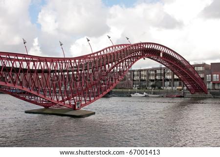 Pedestrian bridge in Amsterdam innercity in the Netherlands - stock photo