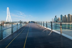 Pedestrian bridge to BlueWaters Island and Dubai Ain. Free space for text.
