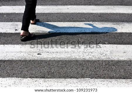 Pedestrian crossing  in back light