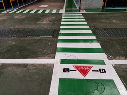 Pedestrian crossing on a repaired asphalt road, Crosswalk on the street for safety, logistic import export and transport industry. Soft focus