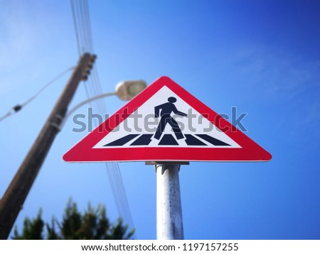 Pedestrian crossing sign. Traffic sign. Road sign.
