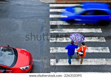 pedestrian crossing with car