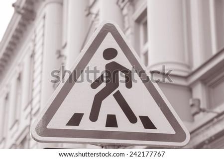 Pedestrian Sign in Urban Setting in Black and White Sepia Tone