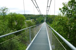 Pedestrian suspension bridge with a length of 483 m above the Rappbode dam (Bode river) in Harz Mountains National Park, near Thale, Germany