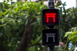 Pedestrian traffic light stylized with oriental themes in Liberdade neighborhood, Japanese and other Asian immigrants reside, Sao Paulo, Brazil