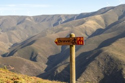 Pedestrian trail sign in the middle of a mountain range. Drave, magical village in Arouca, Portugal