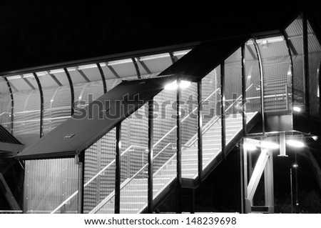 Pedestrian walkway on Train Station at Night. Black and White photo.
