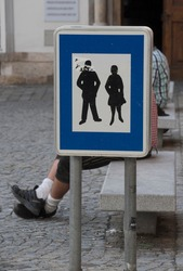 pedestrian zone traffic sign on the street, blue sign with pictogram of pedestrians