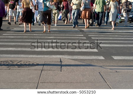 Pedestrians crossing a street of big city