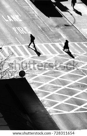 Pedestrians crossing crosswalk, view from above. Second Avenue, New York City.