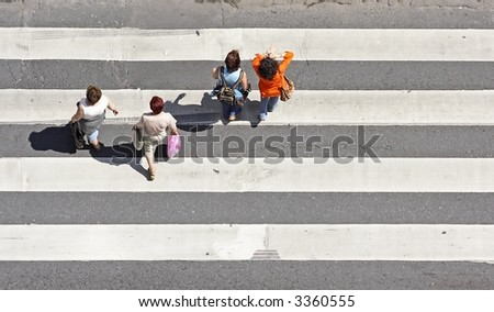 Pedestrians on a zebra crossing - stock photo