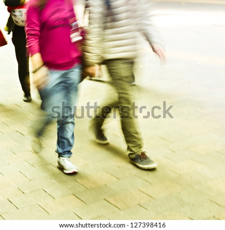 pedestrians walking in the streets in the modern city