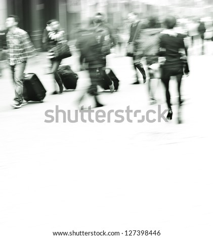 pedestrians walking in the streets in the modern city?black and white