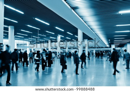 Pedestrians walking in the subway aisle