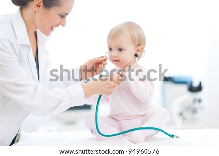 Pediatric doctor wearing baby stethoscope