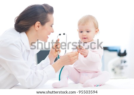 Pediatrician doctor showing baby stethoscope
