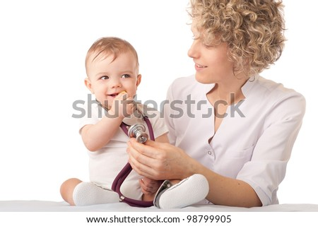 Pediatrician examining baby with stethoscope.