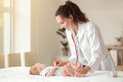 Pediatrician examining little baby in clinic