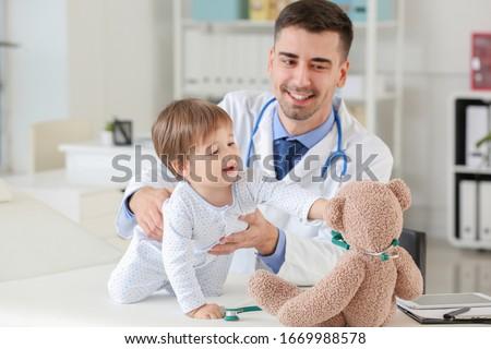 Pediatrician examining little baby in clinic Zdjęcia stock ©