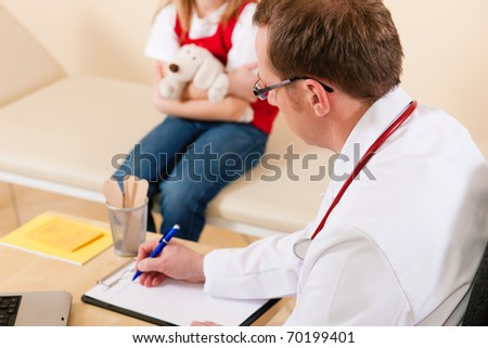 Pediatrician is examining his little patient sitting on a couch and makes some notes