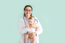 Pediatrician with cute little baby on color background
