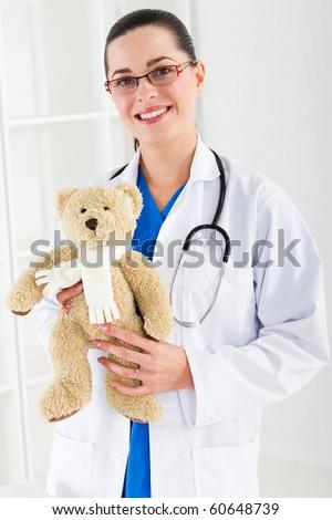 pediatrician with teddy bear