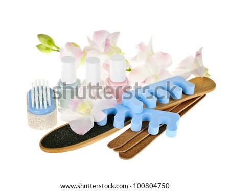 Pedicure accessories and nail polish on white background