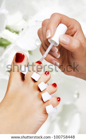 Pedicure in the spa salon in the garden - stock photo