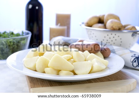 Peeled and cut potatoes, sausage and kale, ingredients for a Dutch stamppot.