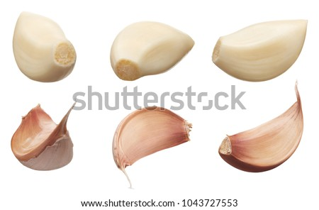 Peeled and unpeeled cloves of garlic in different angles isolated on white background Foto stock ©