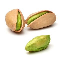 Peeled and unpeeled pistachios on isolated background for package or label design including clipping path